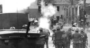 British soldiers fire rubber bullets and use a water cannon at Divis flats in Belfast in July 1973.