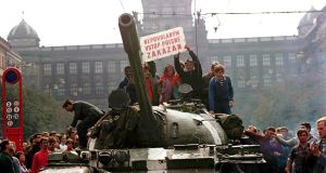 Czechoslovakia, August 1968: Prague residents and students on  top of a Soviet tank in Wenceslas Square. Photograph: Sovfoto/UIG via Getty Images