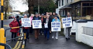 Protesters led by Councillor Donal Grady hand in a letter to the  asylum centre in the former Linden House in  Killarney. The group claims the centre opened without consultation. Photograph: Don MacMonagle