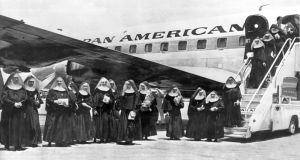 Thirty-eight Roman Catholic nuns of the Order of the Apostolate of the Sacred Heart arrive on a special Pan American refugee flight from Cuba, Miami, Florida, May 18, 1961. Photograph:  Underwood Archives/Getty Images