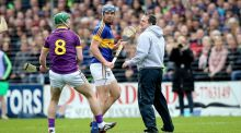 Wexford's Aidan Nolan and manager Davy Fitzgerald confront Tipperary's Jason Forde during the controversial league semi-final incident at Nowlan Park. Photograph: Ryan Byrne/Inpho