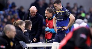 Leinster's Johnny Sexton leaves the field for a head injury assessment after suffering a knock against Exeter. Photograph: Tommy Dickson/Inpho