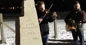 Musicians play a traditional Irish tune at the unveiling of John Montague's gravestone a year after his death.
