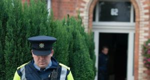 A file image showing a garda outside the house on South Circular Road where 25-year-old  Leo Carolan died. Photograph: Dave Meehan/The Irish Times