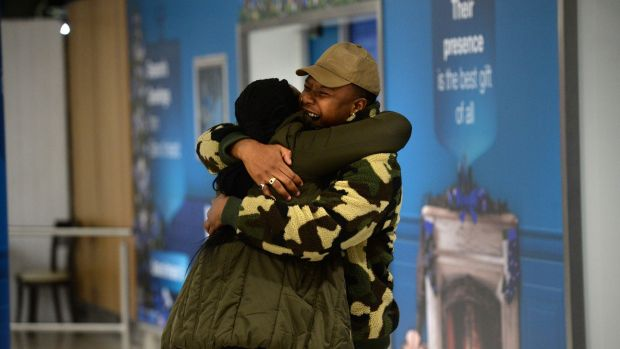 Jacob Maimela greets his sister Vivien Nyathi arriving at Dublin airport from South Africa with her family. Photograph: Dara Mac Dónaill