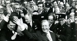 Fianna Fáil leader Charles Haughey waves to supporters outside Leinster House after his election as taoiseach in 1987. Photograph: Jack Mc Manus
