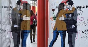 A street art poster of Spanish prime minister Mariano Rajoy kissing Ines Arrimadas, the centre-right party Ciudadanos candidate for the upcoming Catalan regional election. Photograph: Javier Soriano/AFP/Getty