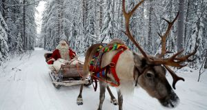 More efficient delivery than Amazon -  Santa Claus in his sleigh  in the Arctic Circle. Photograph: Reuters/Pawel Kopczynski