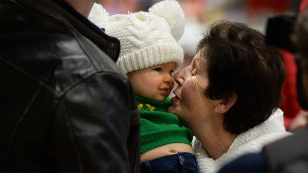 Catherine O'Carroll, from Raheny, meeting her great-granddaughter Charlotte (10 months) at Dublin Airport. Photograph: Dara Mac Dónaill