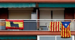 Spanish and Catalonian pro-independence flags hang from balconies in Badalona, Catalonia, a day before the Catalonian regional elections on December 21st, 2017. Photograph: Alberto Estevez/EPA