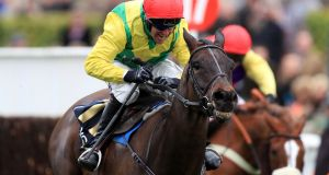 Sizing John   on the way to victory with Robbie Power in the Timico Cheltenham Gold Cup. Jessica Harrington's star will line up in the  Leopardstown Christmas Chase next week. Photograph:  Mike Egerton/PA Wire