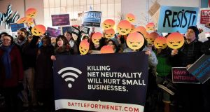 Protestors demonstrate in Boston against the US Federal Communications Commission's move to end internet traffic neutrality. Photograph: Ryan McBride/AFP/Getty Images