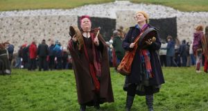 Val Murphy and Maire de Vhal from Cavan at Newgrange for the Winter Solstice. Misty weather blocked the Winter Solstice sunrise from entering the chamber. Photograph: Alan Betson/The Irish Times