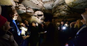 Lucky Winter Solstice lottery winners in the chamber at Newgrange.  Photograph: Alan Betson/The Irish Times
