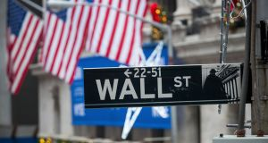 Wall Street sign in front of the NYSE. Photograph: Michael Nagle/Bloomberg