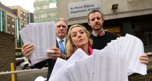 L-R: Noel Smyth (chairman 3ts) together with Fiona and Tim Tuomey deliver a copy of more than 30,000 petition signatures to HSE. Photograph: Dara Mac Donaill/The Irish Times