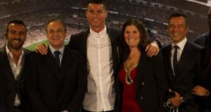 Real Madrid star Cristiano Ronaldo is flanked by his mother and club president Florentino Perez, who has never been close with the Portuguese since his arrival at the club. Photograph: Denis Doyle/Getty Images
