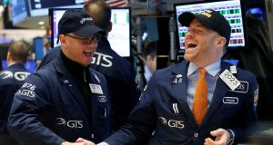 Traders celebrate on the main trading floor of the New York Stock Exchange (NYSE) as the Dow Jones Industrial Average passes the 20,000 mark shortly after the opening of the trading session in New York, U.S., January 25, 2017. REUTERS/Brendan McDermid     TPX IMAGES OF THE DAY Traders celebrate on the main trading floor of the New York Stock Exchange (NYSE) as the Dow Jones Industrial Average passes the 20,000 mark shortly after the opening of the trading session in New York, U.S., January 25, 2017. REUTERS/Brendan McDermid     TPX IMAGES OF THE DAY
