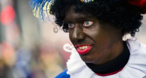 Zwarte Piet is the companion of Saint Nicolas during a yearly feast celebrated on the evening of December 5th. Photograph: Remko de Waal/AFP/Getty Images
