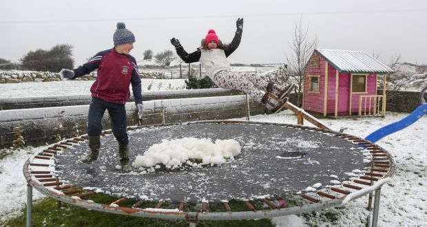 cousins bertie keane and sophie keane playing on a trampoline in the snow in the rahoon - Will It Be A White Christmas