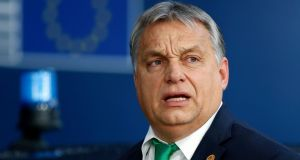 "Hungary's prime minister Viktor Orban: ""It's not even worth starting the [EU] process against Poland as there's no chance to carry it through. Hungary will be there and form a road block they can't get around,"" he said. Photograph: Francois Lenoir/EPA"