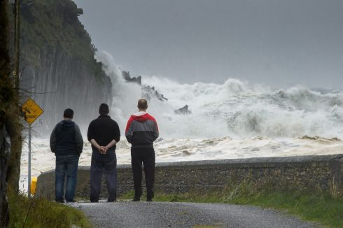 Local Fishermen look out from the Glen Pier Balliskelligs Co.Kerry at the Wild Atlantic seas during Storm Ophelia. Photograph: Stephen Kelleghan.