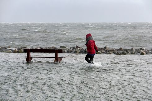 Braving the weather on the flooded Salthill Promenade and car park during Storm Ophelia in October 2017.  Photograph: Joe O'Shaughnessy