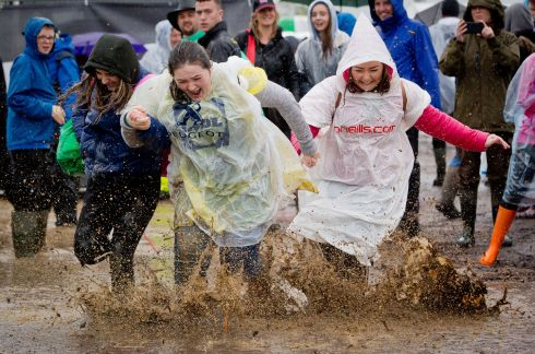 The National Ploughing Championships, Screggan, Tullamore Co Offaly. L to R Rebecca Taylor , Nadine Kelly and Katie Flaherty all from Ballinasloe, Co Galway having fun in the rain at the ploughing.   Photograph: Tom Honan.