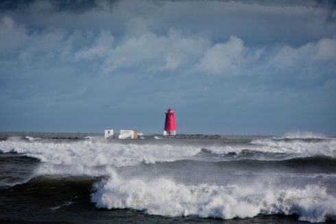 High tide at the Poolbeg Lighthouse in Dublin as Storm Brian hit Dublin .  Photograph: Tom Honan