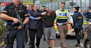 Armed Gardai arrest a man at City West Shopping centre after a chase through west Dublin.  Photograph: Colin Keegan/ Collins