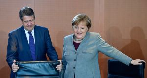 "Former SPD leader Sigmar Gabriel and CDU leader Angela Merkel. ""Across western and northern Europe traditionally left-wing working-class voters are furious at Europe's neo-liberal 'anything goes' status quo."" Photograph: Tobias Schwarz/AFP/Getty Images"