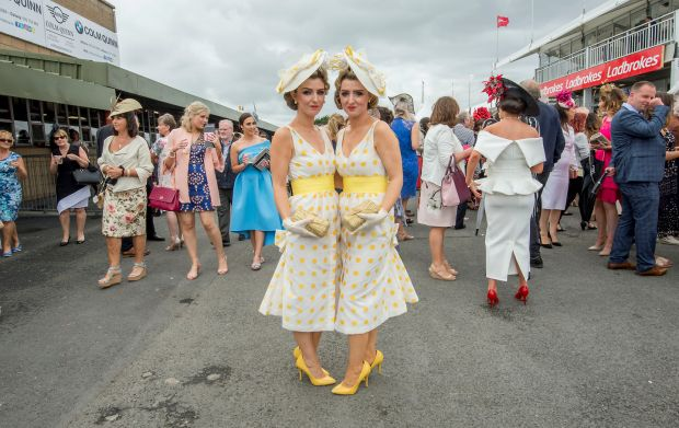 Twins Daninia and Dawn Knight from Portarlington, Co. Laois photographed during Ladies Day at the Galway Races. Photograph: Brenda Fitzsimons / The Irish Times