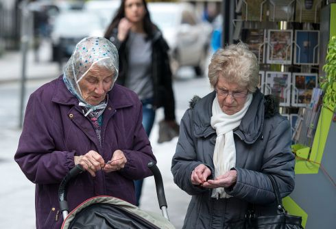 Two women check their scratch cards outside a newsagent's on Sth. King St., Dublin. Photograph: Dave Meehan
