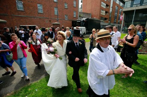 "Role of priest played by Joe Dowling leading the Bride and ""groom"" Councillor Christy Burke and Connie Murphy during the North Inner City Folklore Project ""Bloomsday In The Monto"" for Bloomesday .  Photograph Nick Bradshaw / The Irish Times"