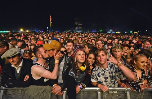 Daniel Harrington (left) kisses his boyfriend Fiachra Sheil at Electric Picnic in September. Photograph: Dave Meehan/The Irish Times