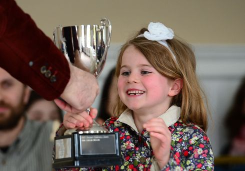 Rachel Morrissey, 7 from Clontarf, Dublin, winner of the  Under 9 violin, receives the cup from adjudicator Georg Baich, at the ESB Feis Ceoil, in the RDS in Dublin in April.  Photograph: Dara Mac Donaill / The Irish Times