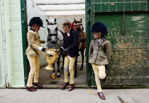 Jack (8),  Mia (8) and Georgia (6)  de Bromhead  from Waterford while pony Apples has a nibble at the Aga Khan Trophy during the launch of the 2017 Dublin Horse Show in August.  Photograph: Alan Betson / The Irish Times
