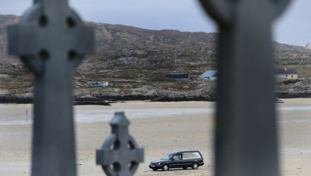 The remains of Pascal Whelan are brought across the sands at low tide to Omey Island in Connemara for burial following funeral mass in nearby Star of the Sea Church in Claddaghduff, Co. Galway in February. 