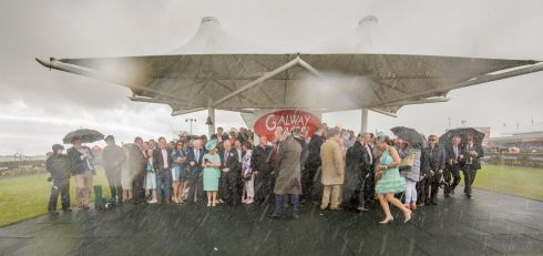 A torrential downpour during the Galway Hurdle at Ladies Day,  Galway Races in August. Photograph: Brenda Fitzsimons / The Irish Times