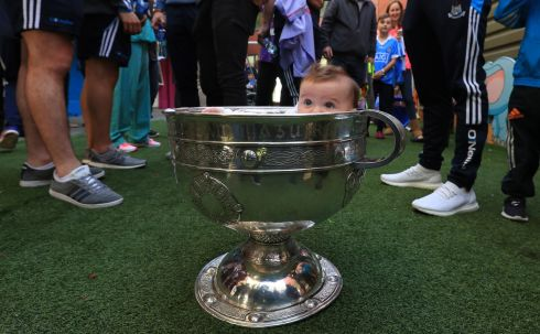 Patient, Molly Brown (6 months) from Donabate in the Sam Maguire cup at Our Lady's Hospital for Sick Children, Crumlin during a visit of the All Ireland winning Dublin team. Photograph: Colin Keegan / Collins Dublin.
