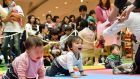 Babies compete in a crawling competition hosted by a Japanese magazine that specialises in pregnancy, childbirth and child-rearing. Photograph:   Kazuhiro Nogi/AFP/Getty Images