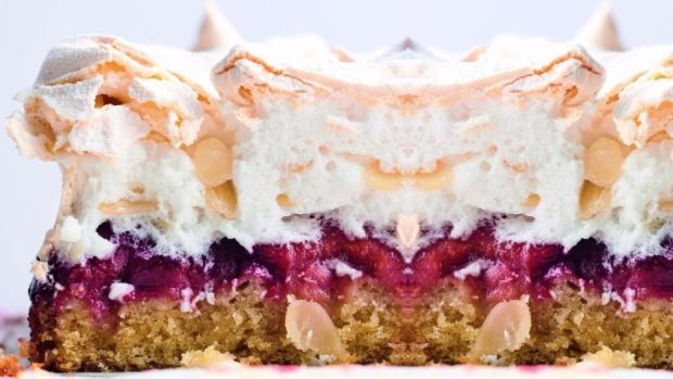 Louise cake with plums and coconut, and a meringue topping