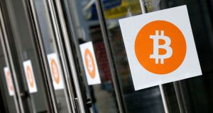 Bitcoin logos: a bitcoin selloff that began at the beginning of the week is gaining momentum, with a quarter of its value evaporating in the past 24 hours. Photograph: Mark Lennihan/AP Photo