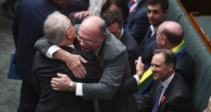 Australian prime minister Malcolm Turnbull hugs Liberal MP Warren Entsch   after the passing of the Marriage Amendment Bill earlier in December. Photograph: Lukas Coch