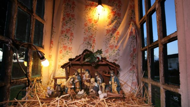 The figurines in the Clooneyquinn crib are illuminated by means of a power line from Richard Cullen's adjacent home. Photograph: Brian Farrell