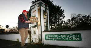 Richard Cullen prepares the former public phone box at Clooneyquinn in Co Roscommon for Christmas. Photograph: Brian Farrell
