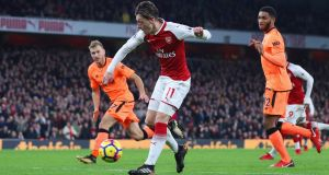 Mesut Özil scores  Arsenal's   third goal during the Premier League match against Liverpool at the Emirates Stadium. Photograph: Catherine Ivill/Getty Images