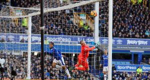 Everton's Ashley Williams heads against  his own bar as goalkeeper Jordan Pickford  during the Premier League game against Chelsea at Goodison Park. Photograph: Phil Noble/Reuters
