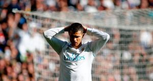 Real Madrid's Cristiano Ronaldo reacts during the Clasico  match against Barcelona  at the Santiago Bernabeu stadium. Photograph: Oscar Del Pozo/AFP/Getty Images