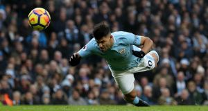 Sergio Agüero heads home  Manchester City's  first goal during the Premier League match against  Bournemouth at the  Etihad Stadium. Photograph: Matthew Lewis/Getty Images